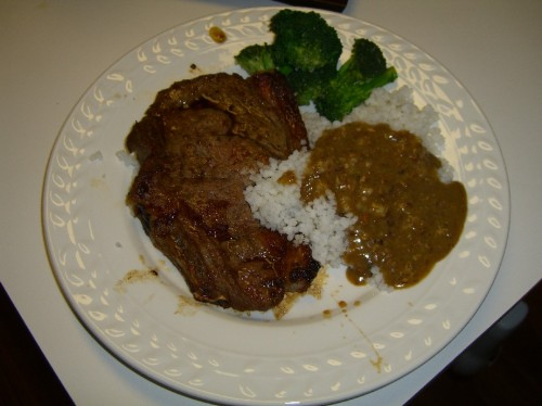 Southern steak, grits and pea gravy