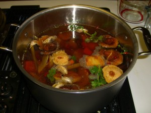Roasted vegetable stock, simmering