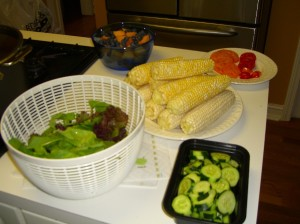 Lettuce, melon, blueberries, tomatoes, sweet corn, cucumbers...mmmm